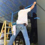 Mechanic measuring the glass window